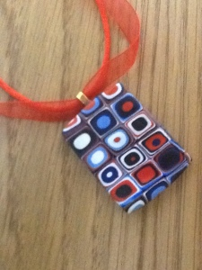Red, blue and white pendant